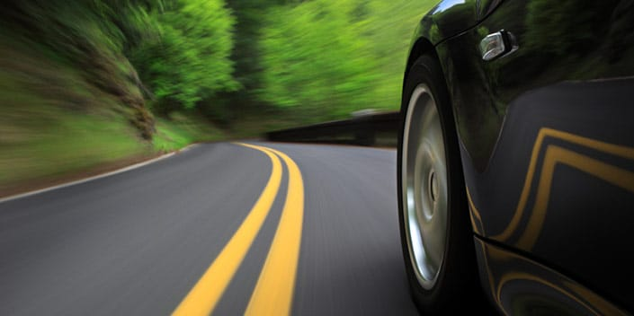 car driving fast on winding road before accident