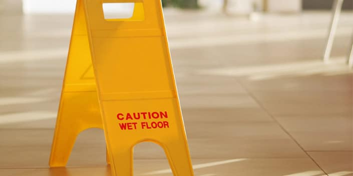 Caution wet floor sign - slip and fall accident personal injury lawyers Edmonton