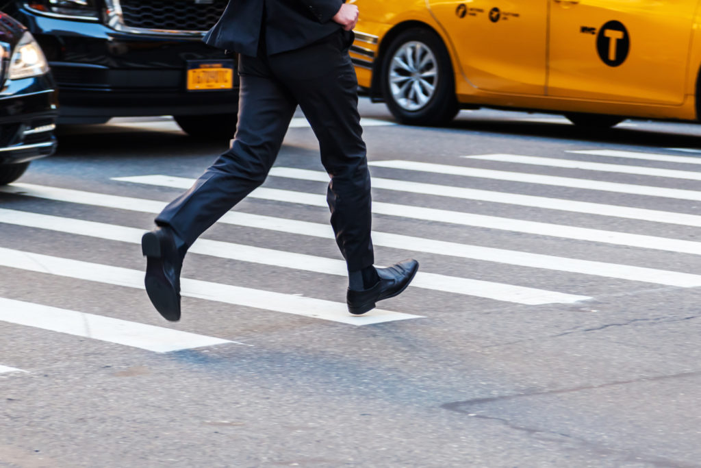 man running across a crosswalk - who is at fault for pedestrian accidents?