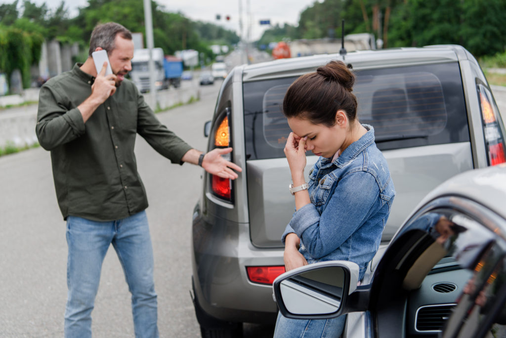 Robinson LLP - car accident lawyers - what not to do after a car accident blog - two people upset after car accident