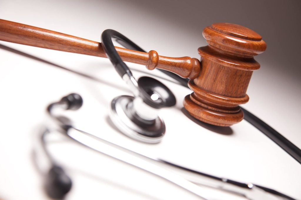 medical malpractice gavel and stethoscope