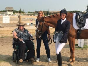 Friend and client of Robinson LLP Marg Kovaluk presenting award to Fiona Carlstrom with Carol Robinson and horse Allegra