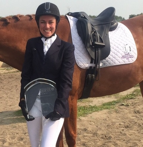 Fiona Carlstrom receiving the Robinson LLP Dressage Award of Excellence Trophy