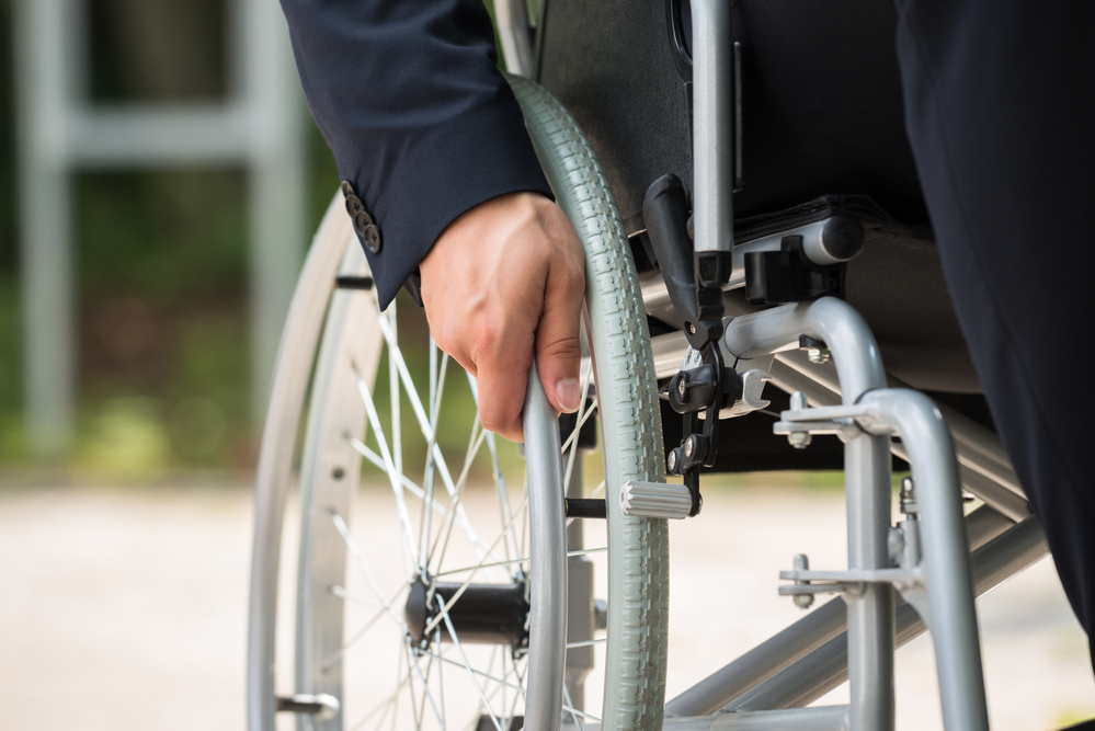 person with spinal cord injury in wheelchair