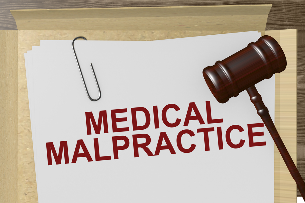 medical malpractice printed on a document with a judge's gavel - why people don't sue their doctors